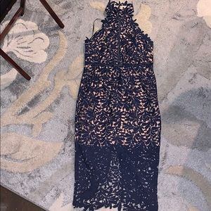 Navy blue lace dress, with blush underlay.